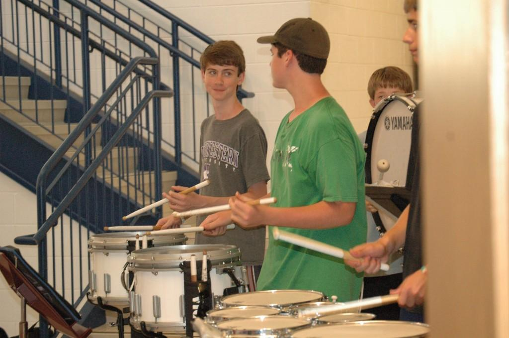 Sophomore Konnor Roelofs keeps the beat with the rest of the drum line in the gym lobby during New Student Orientation on Aug. 16.