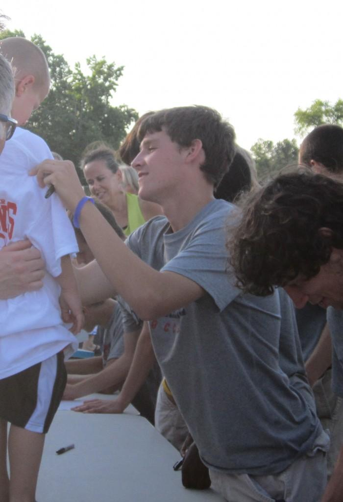 Senior Matt Sheffield signs an autograph at the June 15 State Championship Celebration. The AHS boys beat conference rival Colonial Forge 3-0 on Sunday, June 10.