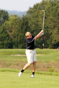Senior captain Caleb Martin makes a big swing at Western.