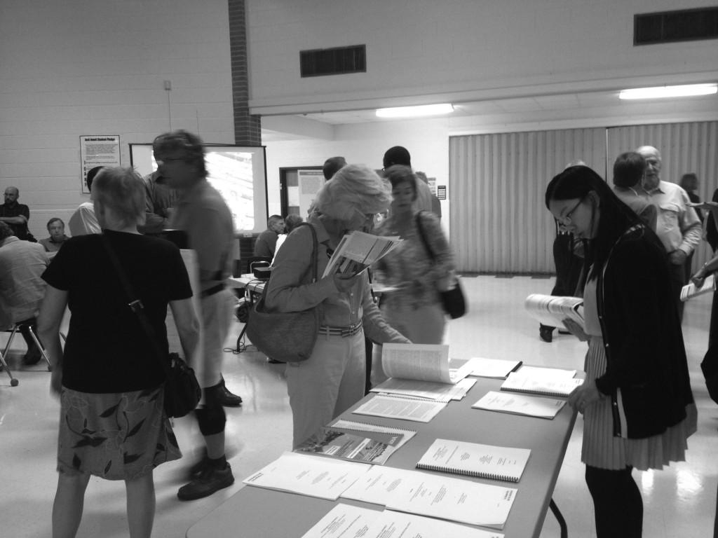 Citizens gather at Jouett to attend VDOT's presentation on the Western Bypass. VDOT employees were on hand to answer questions, while people could leave a written or spoken comment and read information.