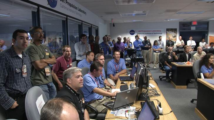Class of 1988 member Jeff Herath (center, wearing a black shirt) watches Curiosity's landing during the