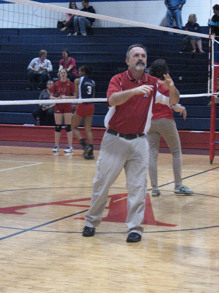 Volleyball coach Mark Ragland catches a ball during warm-ups before the Oct. 2 game against North Stafford. The team won 3-0, bringing the team to 501 games under Ragland.