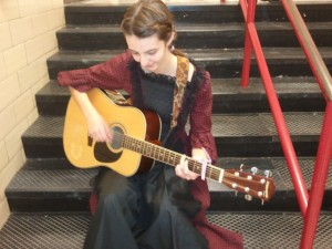 New student strums her way to success
