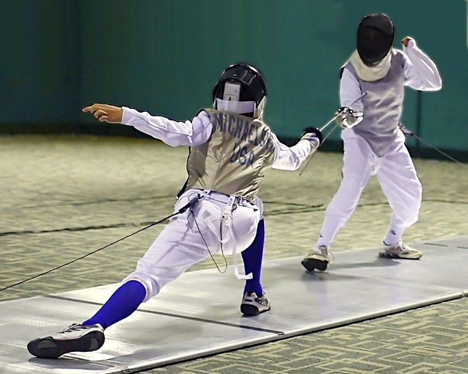 Fencers at the Charlottesville Fencing Alliance. Fencers enjoy tournaments and competing because they say it is fun to meet other fencers and improve by watching others' strategies.