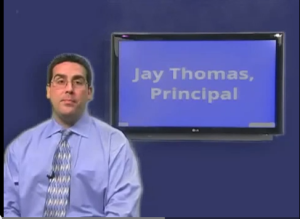 Principal Jay Thomas addresses the student body via the WPAT news channel.
