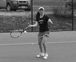 Senior Callie Murray forehands the ball towards her opponent.