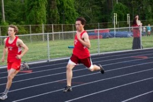 Senior captain James Oh runs during a meet against Orange on May 8, where both the girls' and boys' teams took first place.