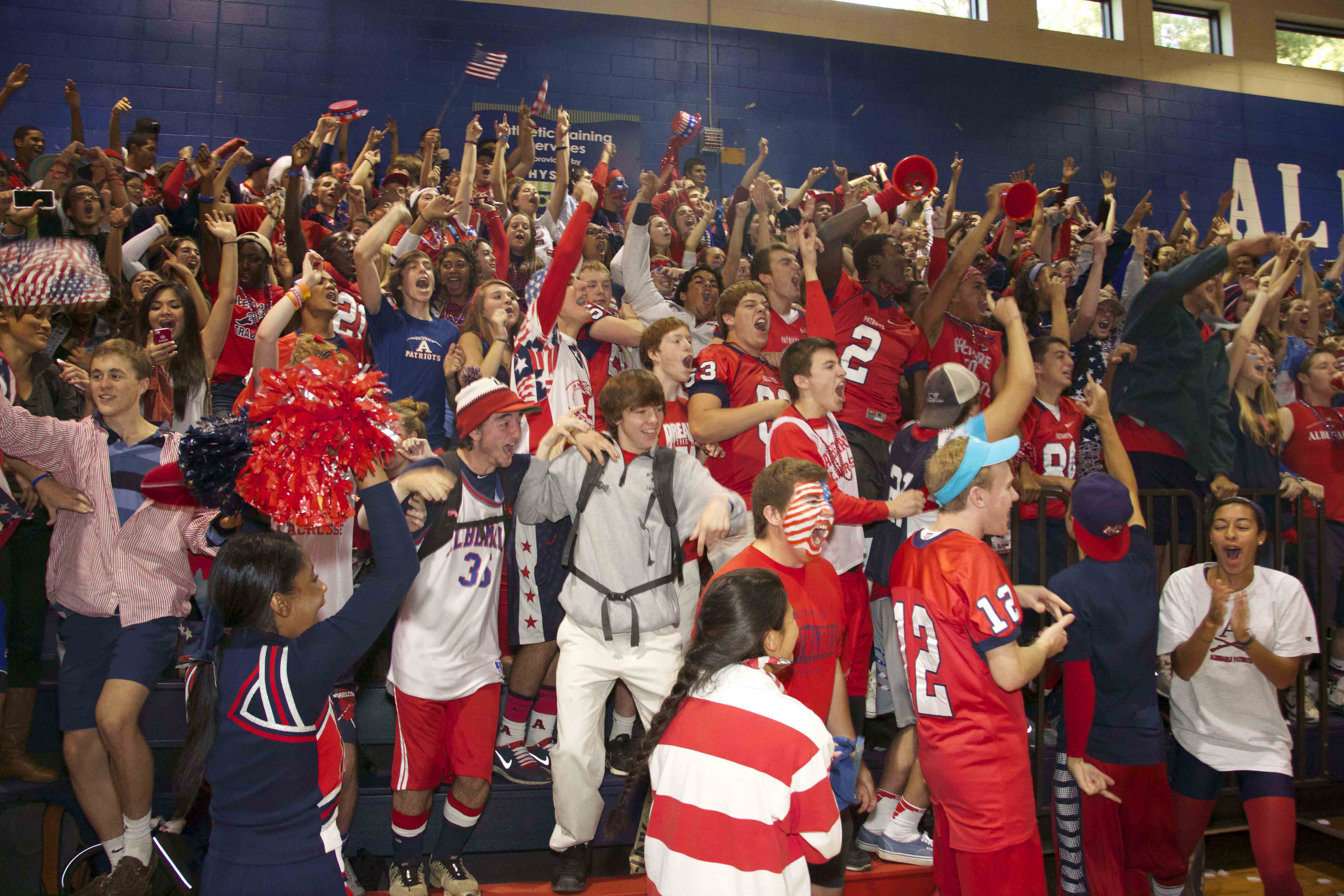 Students cheer at last year's homecoming pep rally decked out in red, white, and blue.