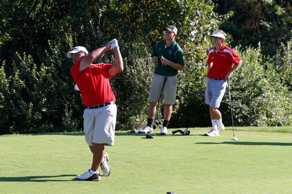Senior Austin Yoon tees off against  William Monroe in a pre-season scrimmage match on Sept. 4.