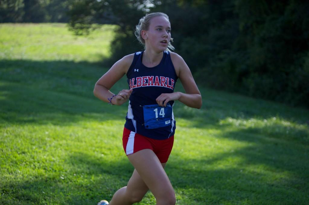 Sophomore Steph Ellena runs during the Ragged Mountain Cup at Panorama Farms on Sept. 3, where the girls' team placed second.