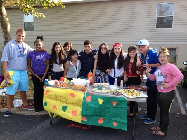 Latinos Unidos (Latinos United or LU) runs their organization's booth at the homecoming tailgate.
