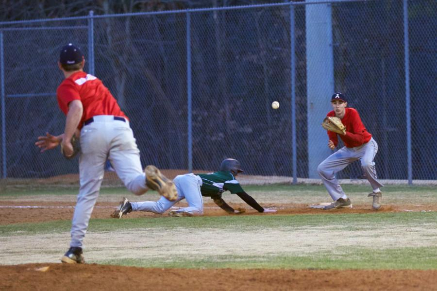 Senior pitcher Dwayne Wood shoots the ball to Sophomore first baseman Jacob Nash in their 2-1 victory over Louisa on April 24.