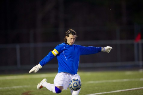 Senior goaltender Matt Natale punts the ball during a home game against Western on April 10. The Patriots lost in a close game of 0-1 against the Warriors.