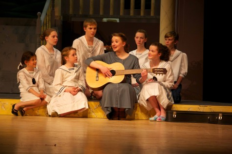 "Junior Olivia Whicheloe, playing Maria Rainer, sings ""Do-Re-Mi"" with the von Trapp children, played by (L-R) Anya Rothman, sophormore Sara Madison Gildersleeve-Price, Sarah Beiter, freshman Doug Kulow, junior Stephanie Owen, Landon Duval and freshman Annalise Livingston. ""I like 'Do-Rei-Mi.' It's her first real moment alone with the kids,"" Whicheloe said. ""It's her way of saying 'hi' and 'this is who I am' and I'm not going to change who I am. I want to see what I can do to change you to make you happier."""