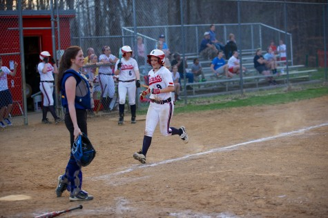 Senior pitcher Emily McAllister trots home for one of Albemarle's 14 runs in a blowout win over Western Albemarle 14-4 on April 11.
