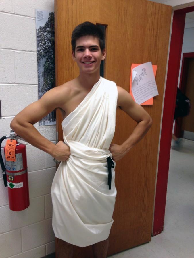 Senior Kevin Bromberger posing in his toga during spirit week.