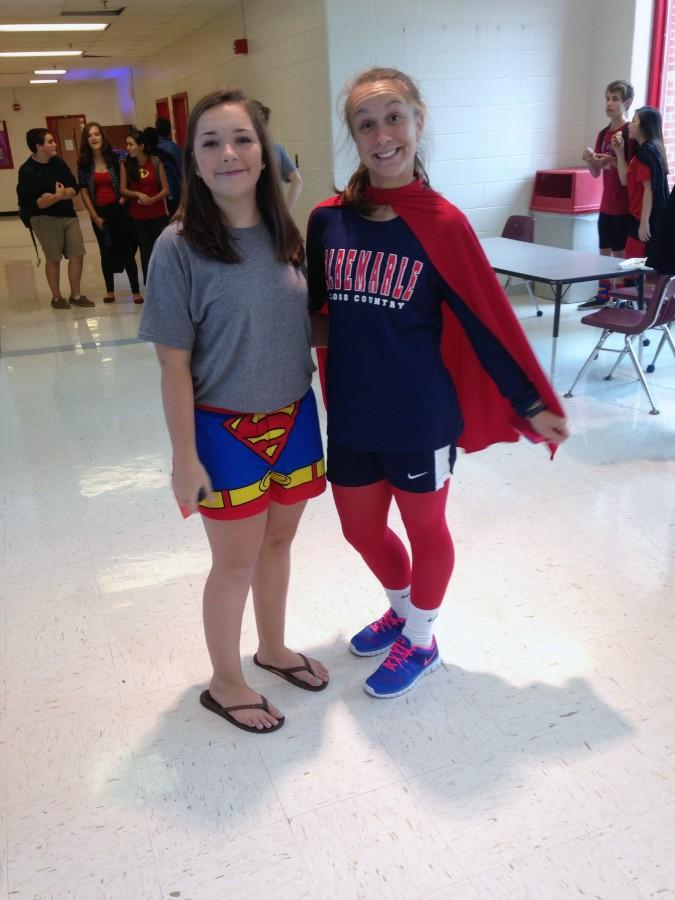 Sophomores Melissa Stacy and Camryn Lutz show their superhero outfits during spirit week.