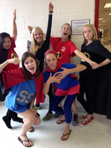 A group of sophomores pose in their superhero costumes for spirit week.