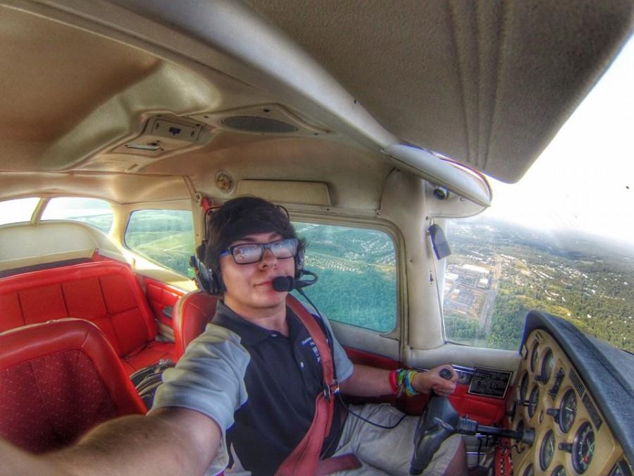 Senior Antonino Grado takes a selfie in the cockpit of  a Cessna 172 Skyhawk after training in the cockpit for over 40 hours.