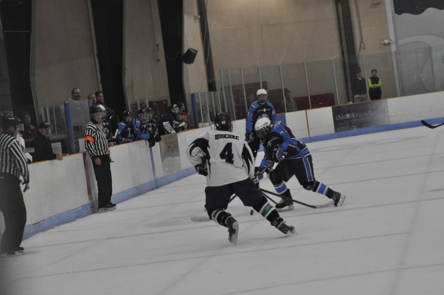 Senior Matt Huschke makes a move for the puck in a game against the Frederick Jr. Freeze. The Blue Ridge Bears compete against other hockey teams throughout Virginia and Maryland.