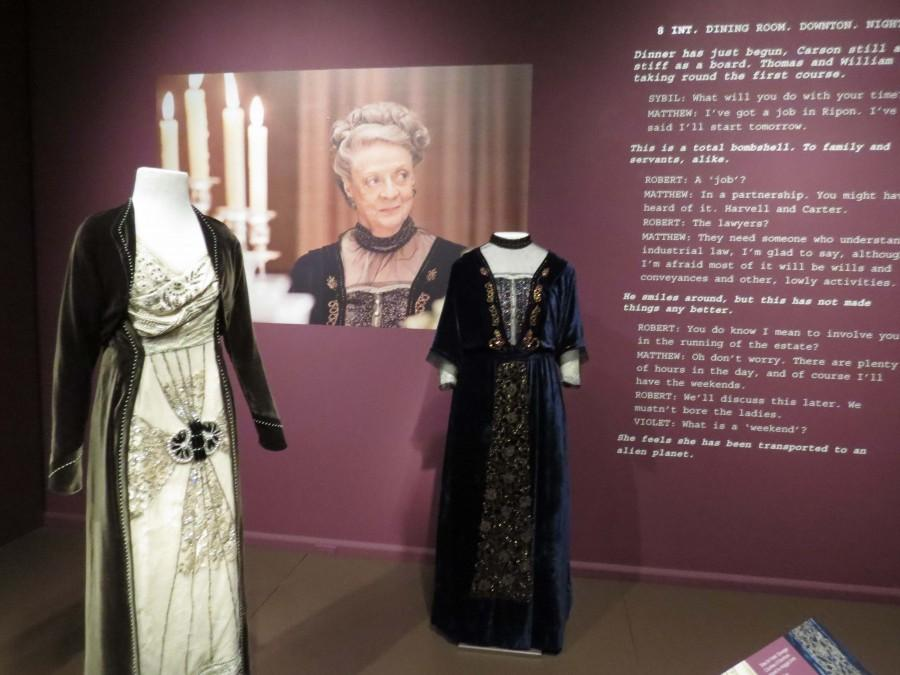 Costumes from Downton Abbey showcased at Winterthur Museum, Garden, and Library. The dark blue dress (right) was worn by the Dowager Countess of Grantham, played by Dame Maggie Smith.