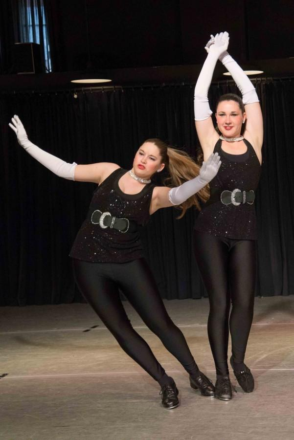 Senior Mecaila McClune dances with partner Lexy Foor in a duo showcase.