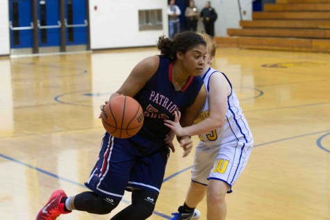 Senior guard KK Barbour drives to the hoop.