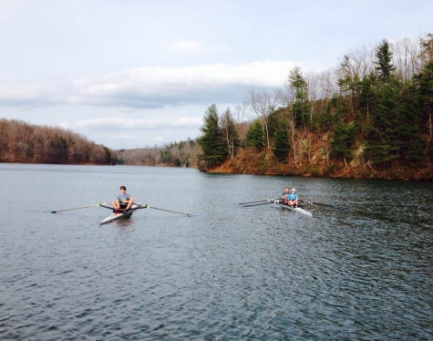 Men's single and women's double sit on the water