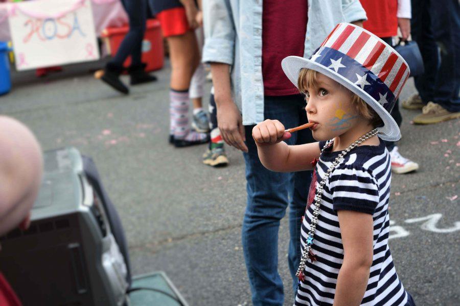 English teacher Hannah Baran's daughter, steps to music at a cake walk sponsored by XXXXX.