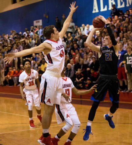 Boys' basketball wins most regular season games in school history.