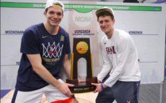Katstra and Kersey hoist the NCAA Championship Trophy. UVA beat Texas Tech 85-77 in overtime.