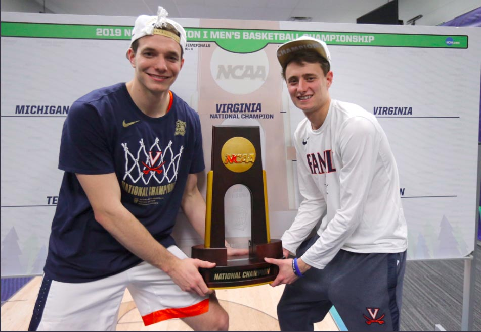 Katstra and Kersey hoist the NCAA Championship Trophy. UVA beat Texas Tech 85-77 in overtime.