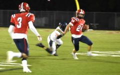 Junior smart safety Nolan Pitsenburger avoids a Fluvanna take-down during the Oct. 19 Homecoming game. The Patriots beat the Fluccos 24-21 after a final-second 27 yard field goal from senior kicker Yousof Algburi.
