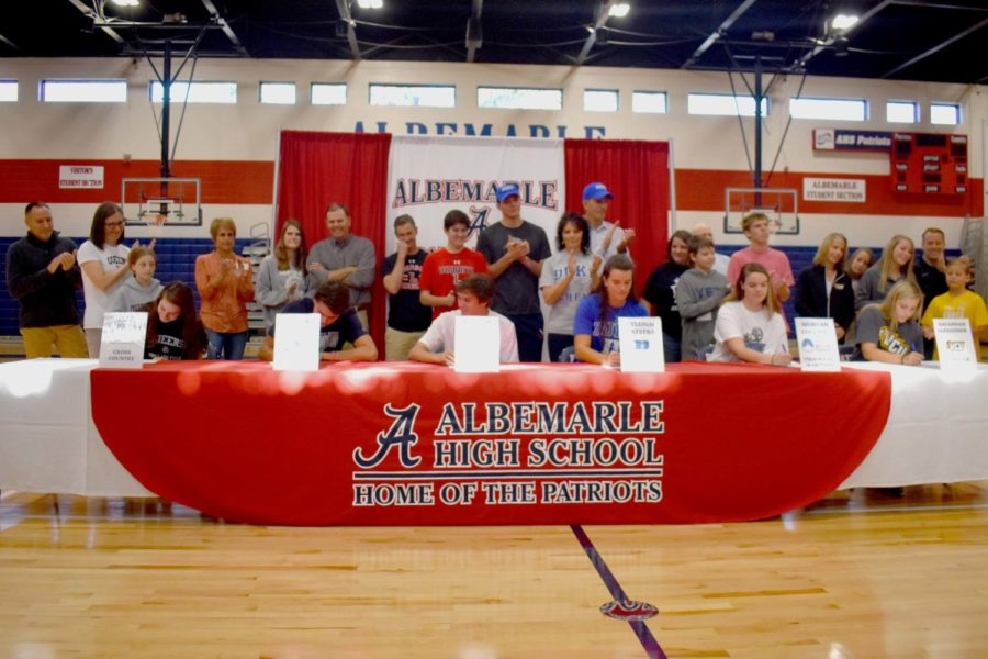 Seniors MeMe Zarzyski, Aidan Shell, Andrew Scanlon, Ryleigh Katstra, Morgan Coleman, and Savannah Alexander sign their letters of intent to be student athletes at a variety of Virginia and North Carolina schools. The athletic department hosted a signing ceremony and reception for the six seniors on Nov. 20.