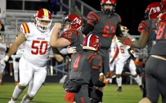 Freshman offensive lineman Tufan Khasanovich Khalilov works to block a Goochland player while junior quarterback Jake King looks for an opening. The Patriots failed to put up any points during the March 3 game.