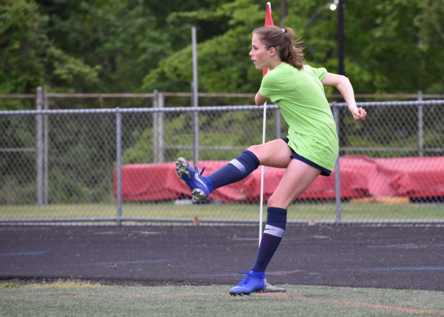 Junior Madeline St. Amand takes a practice kick before a 2019 game.
