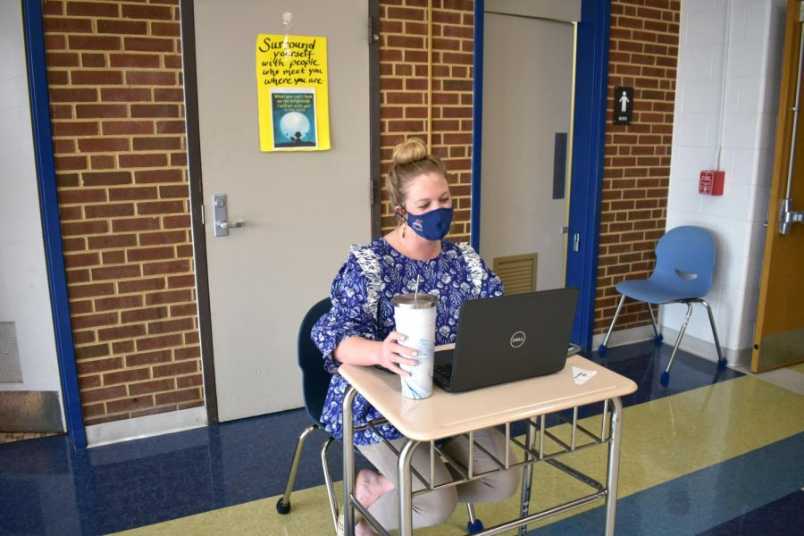 English teacher Abby Sprague monitors the bathrooms during Period 2. With bathrooms closed during class changes, teachers sat outside bathrooms to make sure only one student at a time would use the facilities.