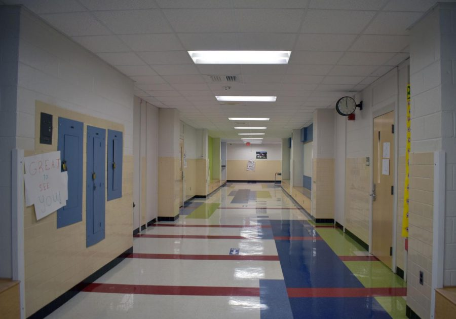 Stickers mark one-way hallways around the school. The hallways are only one-way during class changes; during class students can go whatever direction they need.