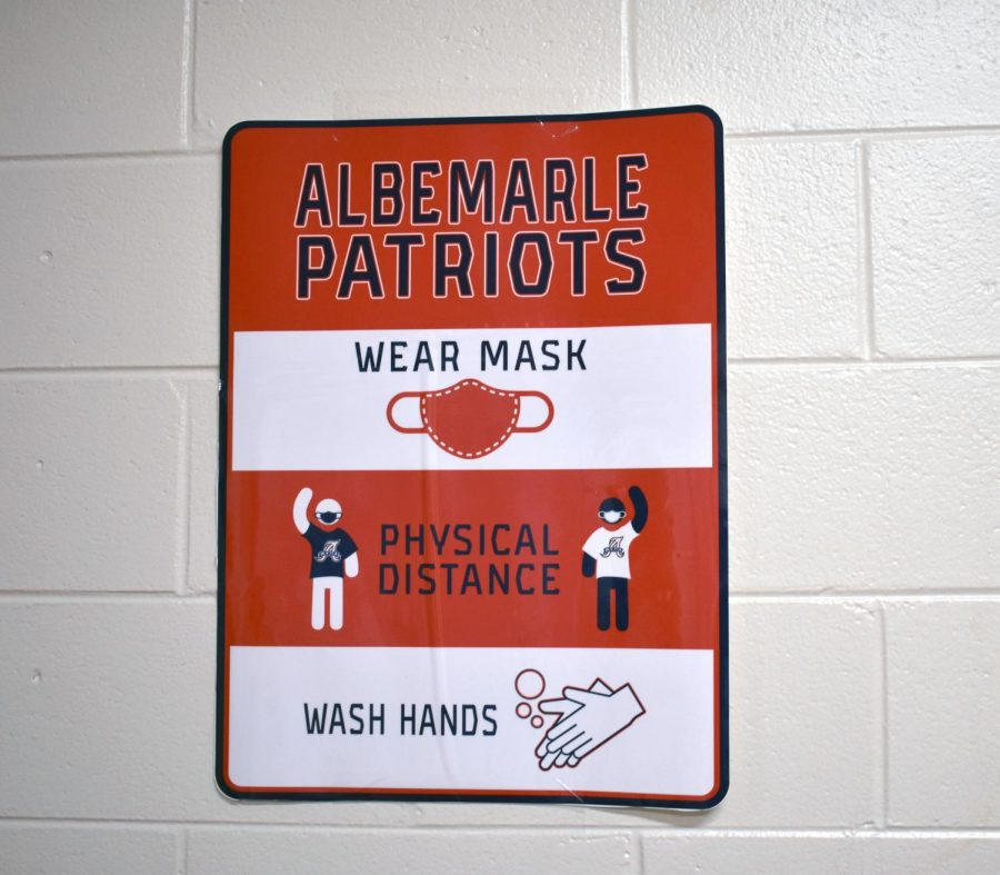 A sign reminds students about how to stay healthy while at school.
