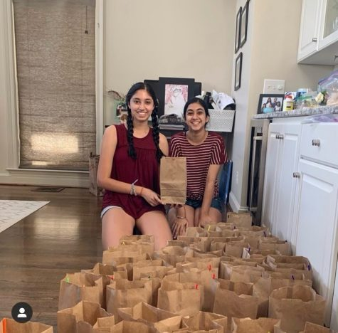 Seniors Aditi Prakash and Rimi Kaur pose at home with some of the STEM kits that they made for local children. Prikash got the idea from attending the MESA BRIDGE camp that Emily Couric Scholarship winner and AHS alum Ayoade Balogun (