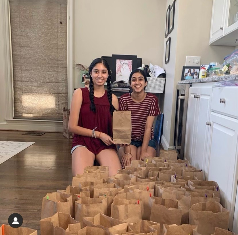 Seniors Aditi Prakash and Rimi Kaur pose at home with some of the STEM kits that they made for local children. Prikash got the idea from attending the MESA BRIDGE camp that Emily Couric Scholarship winner and AHS alum Ayoade Balogun ('17) created.