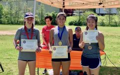 Sophomore Isabella Sonen (left) poses with the other girls who placed at the regional pentathlon event.