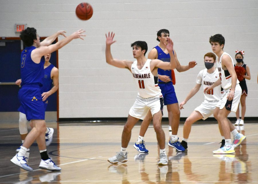 Senior guard Will Hornsby gets ready to steal the ball from WAHS junior guard Luca Tesoriere during the Jan. 19 home game. The Patriots had a 54-51 heartbreaking loss and were denied the opportunity to strike back because of COVID protocols.